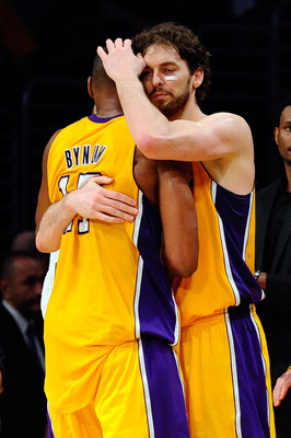 LOS ANGELES, CA - APRIL 20:  Andrew Bynum #17 is hugged by teammate Pau Gasol #16 of the Los Angeles Lakers late in the fourth quarter while taking on the New Orleans Hornets in Game Two of the Western Conference Quarterfinals in the 2011 NBA Playoffs on