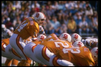 26 Nov 1989:  Quarterback Vinny Testaverde of the Tampa Bay Buccaneers stands behind center during a game against the Phoenix Cardinals at Tampa Stadium in Tampa, Florida.  The Buccaneers won the game, 14-13. Mandatory Credit: Markus Boesch  /Allsport