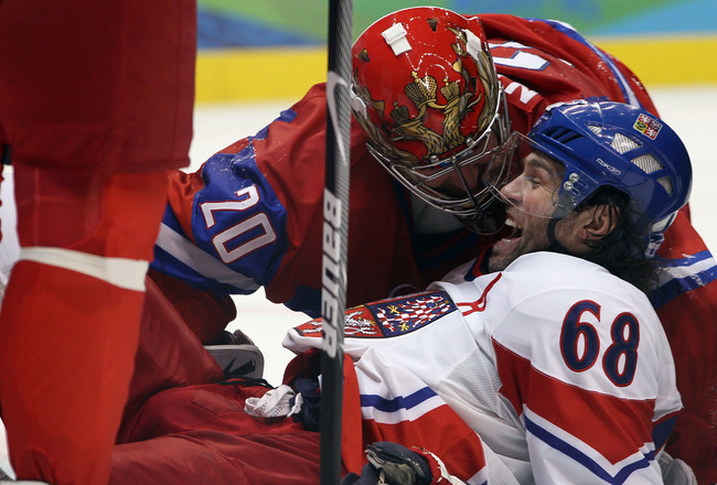 VANCOUVER, BC - FEBRUARY 21: Jaromir Jagr of Czech Republic reacts next to goalkeeper Evgeni Nabokov of Russia during the ice hockey men's preliminary game between Russia and Czech Republic on day 10 of the Vancouver 2010 Winter Olympics at Canada Hockey