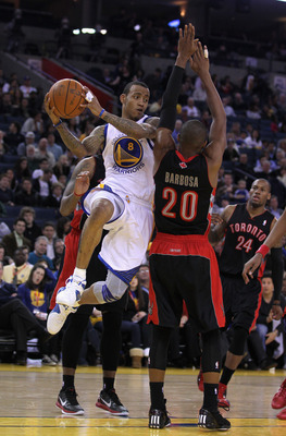 OAKLAND, CA - MARCH 25: Monta Ellis #8 of the Golden State Warriors drives around Leandro Barbosa #20 of the Toronto Raptors at Oracle Arena on March 25, 2011 in Oakland, California. NOTE TO USER: User expressly acknowledges and agrees that, by downloadin