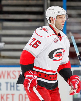ATLANTA, GA - FEBRUARY 13:  Erik Cole #26 of the Carolina Hurricanes reacts after scoring the go-ahead goal in the final seconds of regulation against Bryan Little #10 and the Atlanta Thrashers at Philips Arena on February 13, 2011 in Atlanta, Georgia.  (