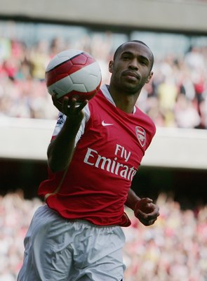LONDON - SEPTEMBER 09:  Thierry Henry of Arsenal celebrates scoring his teams equalising goal from the penalty spot during the Barclays Premiership match between Arsenal and Middlesbrough at The Emirates Stadium on September 9, 2006 in London, England.  (