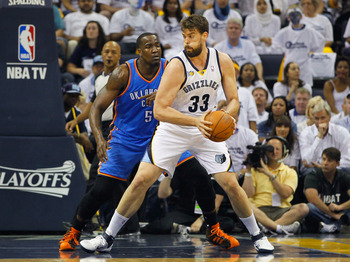 MEMPHIS, TN - MAY 13:  Marc Gasol #33 of the Memphis Grizzlies against Kendrick Perkins #5 of the Oklahoma City Thunder in Game Six of the Western Conference Semifinals in the 2011 NBA Playoffs at FedExForum on May 13, 2011 in Memphis, Tennessee.  NOTE TO