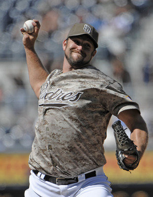SAN DIEGO, CA - JUNE 26: Heath Bell #21 of the San Diego Padres pitches during the ninth inning of a baseball game against the Atlanta Braves at Petco Park on June 26, 2011 in San Diego, California. The Padres won 4-1.  (Photo by Denis Poroy/Getty Images)