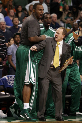 BOSTON, MA - MAY 07:  Assistant coach Lawrence Frank of the Boston Celtics holds back Glen Davis #11 after teammate Rajon Rondo #9 was injured after a scuffle with Dwyane Wade #3 of the Miami Heat in Game Three of the Eastern Conference Semifinals in the