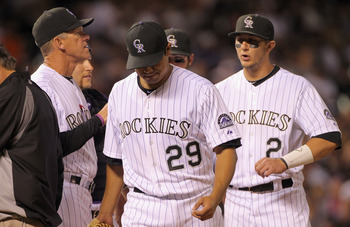 DENVER, CO - APRIL 02:  Starting pitcher Jorge De La Rosa #29 of the Colorado Rockies is removed from the game by manager Jim Tracy #4 in the sixth inning against the Arizona Diamondbacks at Coors Field on April 2, 2011 in Denver, Colorado. De La Rosa ear
