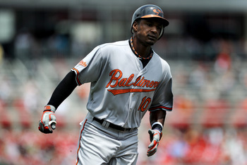 WASHINGTON, DC - JUNE 18: Adam Jones #10 of the Baltimore Orioles runs home after a solo home run against the Washington Nationals in the first inning at Nationals Park on June 18, 2011 in Washington, DC. (Photo by Patrick Smith/Getty Images)