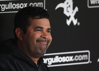 CHICAGO, IL - JUNE 09: Manager Ozzie Guillen #13 of the Chicago White Sox talks with reporters before a game against the Oakland Athletics at U.S. Cellular Field on June 9, 2011 in Chicago, Illinois. (Photo by Jonathan Daniel/Getty Images)