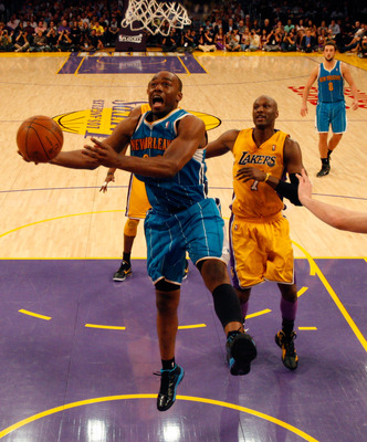 LOS ANGELES, CA - APRIL 26:  Carl Landry #24 of the New Orleans Hornets goes up for a layup in front of Lamar Odom #7 of the Los Angeles Lakers in the second half in Game Five of the Western Conference Quarterfinals in the 2011 NBA Playoffs on April 26, 2