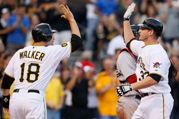 PITTSBURGH - JUNE 25:  Lyle Overbay #37 of the Pittsburgh Pirates is congratulated by Neil Walker #18 after hitting a three run home run in the fourth inning against the Boston Red Sox during the game on June 25, 2011 at PNC Park in Pittsburgh, Pennsylvan