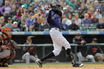DENVER, CO - APRIL 20:  Dexter Fowler #24 of the Colorado Rockies takes an at bat as catcher Buster Posey #28 of the San Francisco Giants backs up the plate at Coors Field on April 20, 2011 in Denver, Colorado.  (Photo by Doug Pensinger/Getty Images)