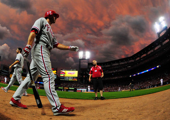 ST. LOUIS, MO - JUNE 21: Chase Utley #26 of the Philadelphia Phillies walks to the on deck circle during a game against the St. Louis Cardinals at Busch Stadium on June 21, 2011 in St. Louis, Missouri.  (Photo by Jeff Curry/Getty Images)