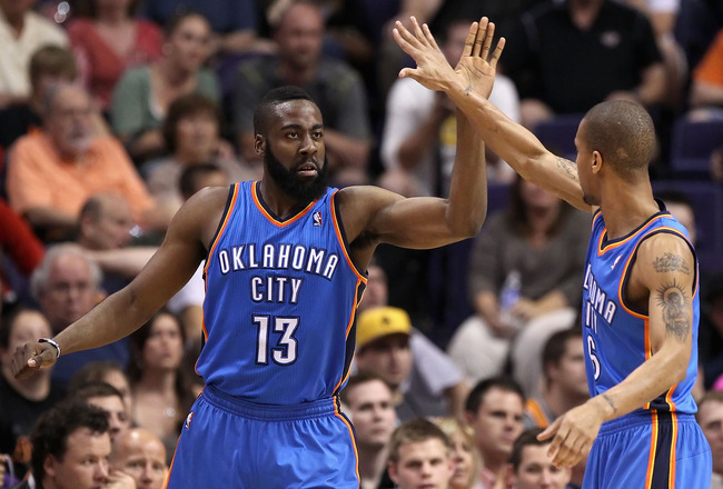 PHOENIX, AZ - MARCH 30:  James Harden #13 of the Oklahoma City Thunder high fives teamate Eric Maynor #6 after scoring against the Phoenix Suns during the NBA game at US Airways Center on March 30, 2011 in Phoenix, Arizona. The Thunder defeated the Suns 1