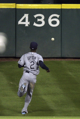 HOUSTON - JUNE 24:  Center fielder B.J. Upton #2 of the Tampa Bay Rays chases a ball down on Tal's Hill on a line drive by Chris Johnson #23 of the Houston Astros in the seventh inning at Minute Maid Park on June 24, 2011 in Houston, Texas.  (Photo by Bob