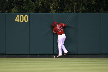 ANAHEIM, CA - JUNE 7:  Center fielder Vernon Wells #10 of the Los Angeles Angels of Anaheim can't catch an RBI double hit by Johnny Damon of the Tampa Bay Rays in the fourth inning on June 7, 2011 at Angel Stadium in Anaheim, California.  (Photo by Stephe