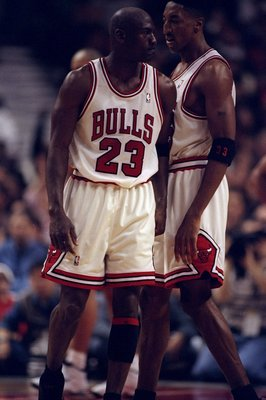 3 May 1998: Michael Jordan #23 bumps Scottie Pippen #33 of the Chicago Bulls during the NBA Playoffs round 1 game against the Charlotte Hornets at the United Center in Chicago, Illinois. The Bulls defeated the Hornets 83-70.