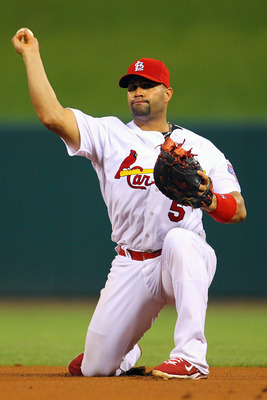 ST. LOUIS, MO - JUNE 17: Albert Pujols #5 of the St. Louis Cardinals throws to first base against the Kansas City Royals at Busch Stadium on June 17, 2011 in St. Louis, Missouri.  (Photo by Dilip Vishwanat/Getty Images)