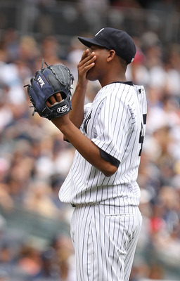 NEW YORK, NY - JUNE 26:  Ivan Nova #47 of the New York Yankees reacts after giving up a home run to Ty Wigginton #21 of the Colorado Rockies during their game on June 26, 2011 at Yankee Stadium in the Bronx borough of New York City.  (Photo by Al Bello/Ge