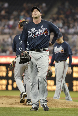 SAN DIEGO, CA - JUNE 24: Derek Lowe #32 of the Atlanta Braves walks off the mound after being pulled during the sixth inning of a baseball game against the San Diego Padres at Petco Park on June 24, 2011 in San Diego, California.  (Photo by Denis Poroy/Ge