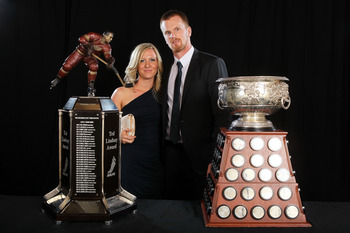 LAS VEGAS, NV - JUNE 22:  Daniel Sedin of the Vancouver Canucks poses with his wife Marinette Sedin after winning the Art Ross Trophy and the Ted Lindsay Award during the 2011 NHL Awards at The Pearl concert theater at the Palms Casino Resort June 22, 201