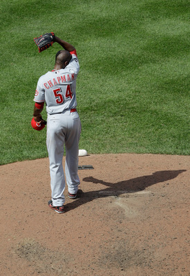 BALTIMORE, MD - JUNE 26: Pitcher Aroldis Chapman #54 of the Cincinnati Reds reacts after giving up a solo home run to Luke Scott #30 of the Baltimore Orioles (not pictured) during the seventh inning at Oriole Park at Camden Yards on June 26, 2011 in Balti