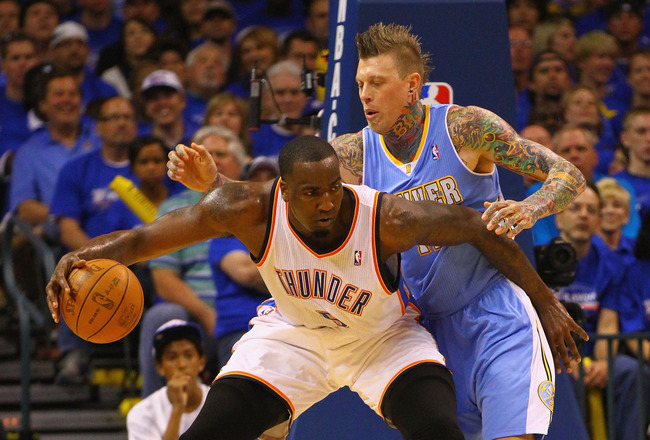 OKLAHOMA CITY, OK - APRIL 17: Kendrick Perkins #5 of the Oklahoma City Thunder looks to shoot the ball against Chris Andersen #11 of the Denver Nuggets in Game One of the Western Conference Quarterfinals in the 2011 NBA Playoffs on April 17, 2011 at the F