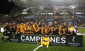 BRIDGEVIEW, IL - AUGUST 05: Members of Tigres UANL including captain Fernando Ortiz (seated, front) celebrate winning the SuperLiga 2009 Final against the Chicago Fire on August 5, 2009 at Toyota Park in Bridgeview, Illinois. Tigres UANL defeated the Fire