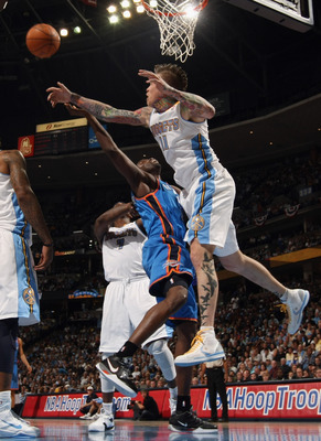 DENVER, CO - APRIL 23:  Chris Andersen #11 of the Denver Nuggets blocks a shot by Kevin Durant #35 of the Oklahoma City Thunder in Game Three of the Western Conference Quarterfinals in the 2011 NBA Playoffs on April 23, 2011 at the Pepsi Center in Denver,