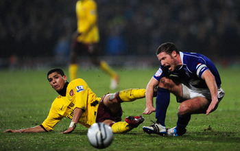 IPSWICH, ENGLAND - JANUARY 12: Denilson of Arsenal tackles David Norris of Ipswich Town during the Carling Cup Semi Final First Leg match between Ipswich Town and Arsenal at Portman Road on January 12, 2011 in Ipswich, England.  (Photo by Jamie McDonald/G