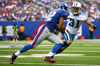 EAST RUTHERFORD, NJ - SEPTEMBER 26: Steve Smith #12 of the New York Giants runs the ball against Cortland Finnegan #31 of the Tennessee Titans at New Meadowlands Stadium on September 26, 2010 in East Rutherford, New Jersey. The Titans defeated the Giants