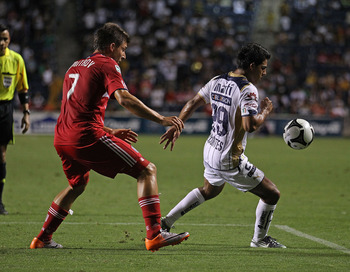 BRIDGEVIEW, IL - JULY 20: Javier Cortes #29 of Pumas UNAM chases down the ball under pressure from Stefan Dimitrov #7 of the Chicago Fire during a SuperLiga 2010 match at Toyota Park on July 20, 2010 in Bridgeview, Illinois. The Fire defeated Pumas UNAM 1