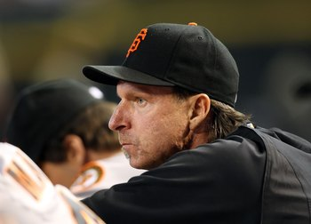 PHOENIX - JUNE 11:  Pitcher Randy Johnson #51 of the San Francisco Giants watches from the dugout during the major league baseball game against the Arizona Diamondbacks at Chase Field on June 11, 2009 in Phoenix, Arizona.  The Diamondbacks defeated the Gi