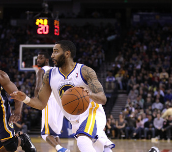OAKLAND, CA - JANUARY 19:  Acie Law #2 of the Golden State Warriors in action against the Indiana Pacers at Oracle Arena on January 19, 2011 in Oakland, California.  NOTE TO USER: User expressly acknowledges and agrees that, by downloading and or using th