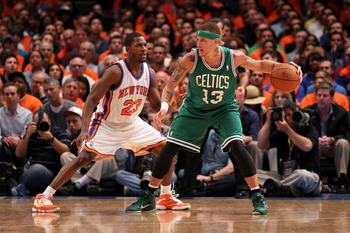 NEW YORK, NY - APRIL 24:  Delonte West #13 of the Boston Celtics looks to pass against Toney Douglas #23 of the New York Knicks in Game Four of the Eastern Conference Quarterfinals during the 2011 NBA Playoffs on April 24, 2011 at Madison Square Garden in