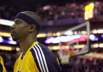 PHOENIX - DECEMBER 03:  T.J. Ford #5 of the Indiana Pacers stands with teammates for the National Anthem before the NBA game against the Phoenix Suns at US Airways Center on December 3, 2010 in Phoenix, Arizona. NOTE TO USER: User expressly acknowledges a