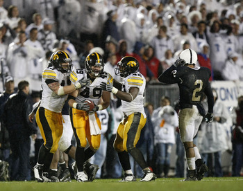 STATE COLLEGE, PA - SEPTEMBER 26:  A.J. Edds #49 of the Iowa Hawkeyes celebrates a fourth quarter interception with Pat Angerer #43 and Jeremiha Hunter #42 in front of Chaz Powell #2 of the Penn State Nittnay Lions  on September 26, 2009 at Beaver Stadium