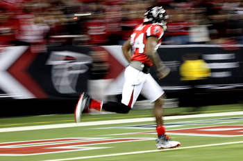 ATLANTA, GA - JANUARY 15:  Roddy White #84 of the Atlanta Falcons runs onto the field during player introducitons against the Green Bay Packers during their 2011 NFC divisional playoff game at Georgia Dome on January 15, 2011 in Atlanta, Georgia.  (Photo