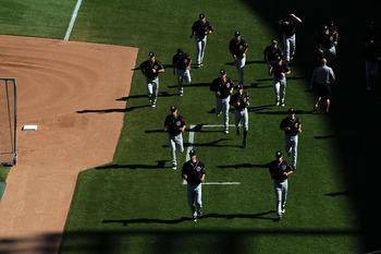 OMAHA, NE - JUNE 27:  The South Carolina Gamecocks warm up before play against the Florida Gators during game1 of the men's 2011 NCAA College Baseball World Series at TD Ameritrade Park Omaha on June 27, 2011 in Omaha, Nebraska.  (Photo by Ronald Martinez