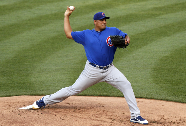 KANSAS CITY, MO - JUNE 25:  Starting pitcher Carlos Zambrano #38 of the Chicago Cubs throws against the Kansas City Royals at Kauffman Stadium on June 25, 2011 in Kansas City, Missouri. (Photo by Ed Zurga/Getty Images)
