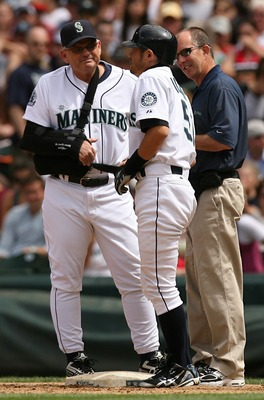 SEATTLE - JULY 15:  Ichiro Suzuki #51 of the Seattle Mariners is checked on by manager John McLaren #8 and trainer Rick Griffin after being hit in the knee by a pitch against the Detroit Tigers on July 15, 2007 at Safeco Field in Seattle, Washington.  (Ph
