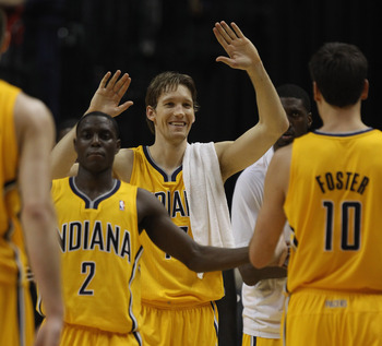INDIANAPOLIS, IN - APRIL 23: Darren Collison #2 and Mike Dunleavy #17 of the Indiana Pacers welcome teammates to the bench during a time-out late against the Chicago Bulls in Game Four of the Eastern Conference Quarterfinals in the 2011 NBA Playoffs at Co