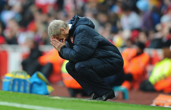 LONDON, ENGLAND - NOVEMBER 20:  Arsenal manager Arsene Wenger reacts to Tottenham's winning goal during the Barclays Premier League match between Arsenal and Tottenham Hotspur at the Emirates Stadium on November 20, 2010 in London, England.  (Photo by Mik