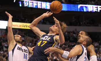 DALLAS, TX - FEBRUARY 23:  Forward Anrei Kirilenko #47 of the Utah Jazz is fouled by Jason Kidd #2 of the Dallas Mavericks at American Airlines Center on February 23, 2011 in Dallas, Texas.  NOTE TO USER: User expressly acknowledges and agrees that, by do