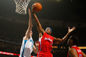 NEW ORLEANS - NOVEMBER 09:  Craig Smith #1 of the Los Angeles Clippers grabs a rebound over Jason Smith #14 of the New Orleans Hornets at the New Orleans Arena on November 9, 2010 in New Orleans, Louisiana. The Hornets defeated the Clippers 101-82.   NOTE