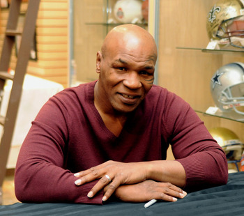 LAS VEGAS - FEBRUARY 4:  In this handout photo provided by Las Vegas News Bureau, former heavyweight boxing champion Mike Tyson attends an autograph-signing session  in the Miracle Mile Shops at Planet Hollywood Resort & Casino on February 4, 2011 in Las