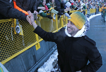 GREEN BAY, WI - FEBRUARY 08: Green Bay Packers quarterback Aaron Rodgers slaps the hands of fans as he leaves the field after the Packers victory ceremony at Lambeau Field on February 8, 2011 in Green Bay, Wisconsin.  (Photo by Matt Ludtke/Getty Images)