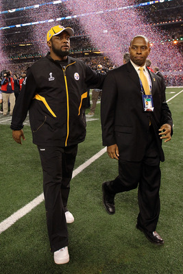 ARLINGTON, TX - FEBRUARY 06:  (L) Head coach Mike Tomlin of the Pittsburgh Steelers walks off of the field after they were defeated 31 to 25 by the Green Bay Packers during Super Bowl XLV at Cowboys Stadium on February 6, 2011 in Arlington, Texas.  (Photo
