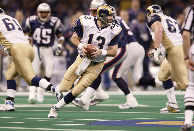 03 Feb 2002:   Quarterback Kurt Warner of the St.Louis Rams looks for an opening against the New England Patriots during Superbowl XXXVI at the Superdome in New Orleans, Louisiana.  The Patriots won 20-17, with a 48-yard field goal by kicker Adam Vinatier