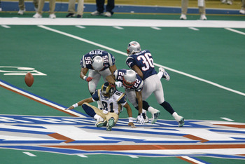 03 Feb 2002:   Az-Zahir Hakim #81 of the St.Louis Rams looses the ball to Roman Phifer #95 and Terrance Shaw #22 of the New England Patriots during Superbowl XXXVI at the Superdome in New Orleans, Louisiana.  The Patriots defeated the Rams 20-17. DIGITAL