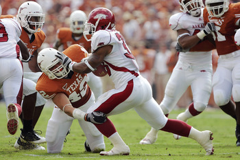AUSTIN, TX - SEPTEMBER 27: Linebacker Dustin Earnest #42 of the Texas Longhorns wraps up tailback Dennis Johnson #33 of the Arkansas Razorbacks behind the line of scrimmage in the second quarter on September 27, 2008 at Darrell K Royal-Texas Memorial Stad